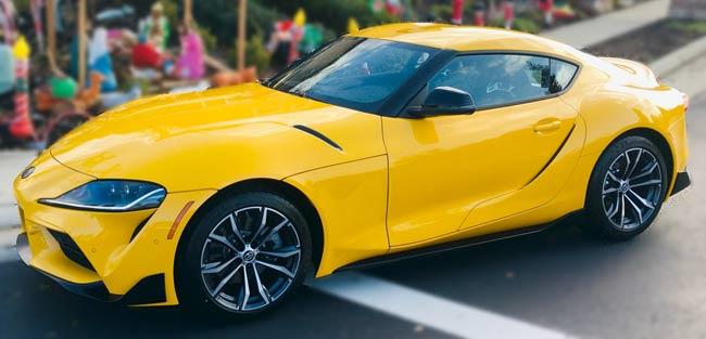 yellow Toyota Supra