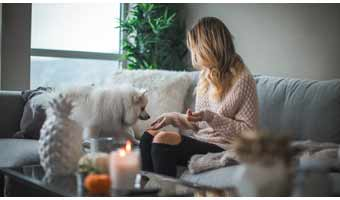 women at home with pets