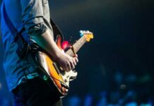 concerts guitarist playing Strat